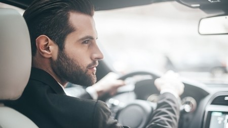 Young businessman driving