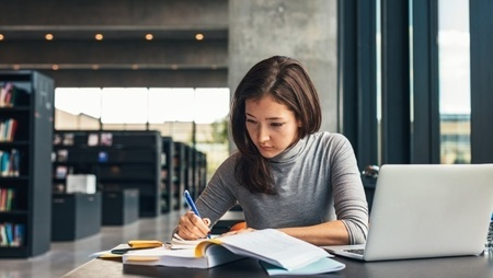 female masters student studying