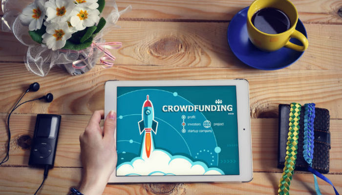 Crowdfunding campaign on tablet