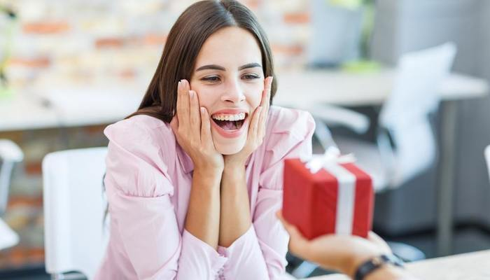 Excited woman receiving gift