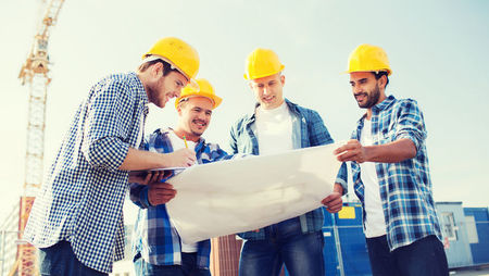 Construction workers reading building plans