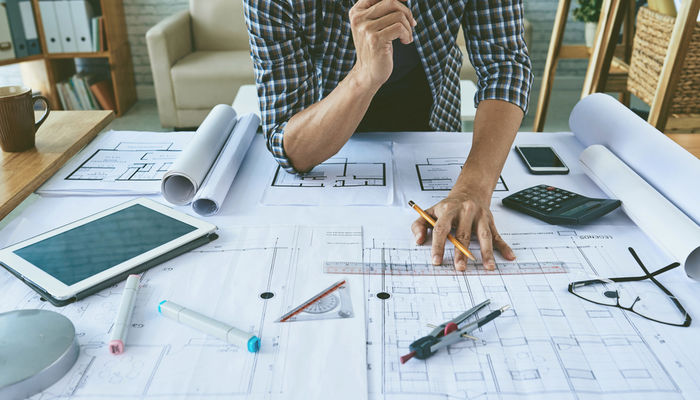 Male architect working on construction plans