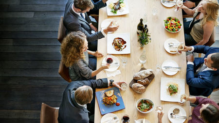 Overhead view of a group of business people eating lunch