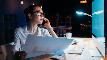 A young businesswoman working in the office at night
