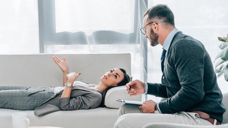 Male psychologist with female patient