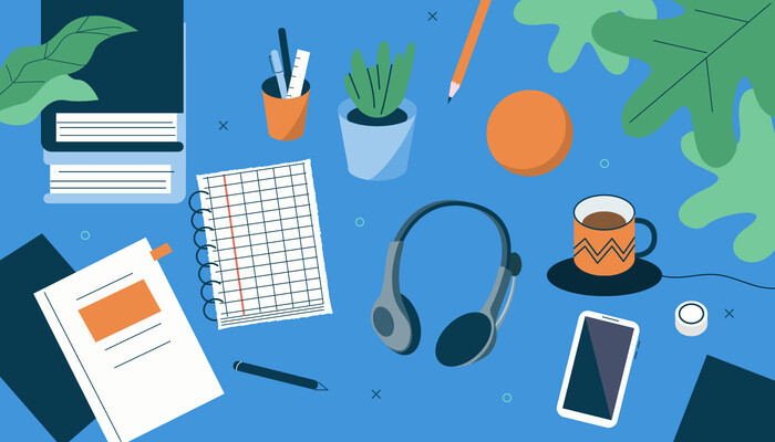 Illustration of a blue desk topped with various essentials like a notepad, a headset, a phone, a coffee mug, books and plants