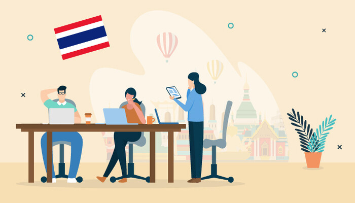 Illustration of two people working on their laptops and sitting at a desk and another woman standing there while holding a tablet, there is a backdrop of Bangkok and the Thai flag